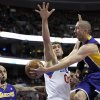 Photo - Los Angeles Lakers' Steve Blake, right, passes the ball to Robert Sacre, left, as Philadelphia 76ers' Spencer Hawes, center, defends during the first half of an NBA basketball game on Friday, Feb. 7, 2014, in Philadelphia. (AP Photo/Michael Perez)