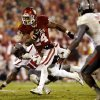 Brennan Clay (24) carries in the final minutes during a college football game where the University of Oklahoma Sooners (OU) defeated the Texas Tech Red Raiders 38-30 at Gaylord Family-Oklahoma Memorial Stadium in Norman, Okla., on Saturday, Oct. 26, 2013. Photo by Steve Sisney, The Oklahoman