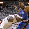 Miami\'s LeBron James (6) drives past Oklahoma City\'s Thabo Sefolosha (2) during Game 3 of the NBA Finals between the Oklahoma City Thunder and the Miami Heat at American Airlines Arena, Sunday, June 17, 2012. Photo by Bryan Terry, The Oklahoman