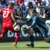Photo - Toronto FC forward Luke Moore, left, vies for the ball with Columbus Crew goalkeeper Steve Clark during the first half of an MLS soccer game in Toronto on Saturday, May 31, 2014. (AP Photo/The Canadian Press, Nathan Denette)