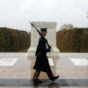 CLARIFIES WHEN PHOTO WAS MADE - This handout photo taken in the morning before the cemetery was closed for the day and provided by the U.S. Army, shows Spc. Brett Hyde, Tomb Sentinel, 3d U.S. Infantry Regiment (The Old Guard), keeping guard over the Tomb of the Unknown Soldier as Hurricane Sandy approaches, at Arlington National Cemetery, Va., Monday, Oct. 29, 2012. Just like the Sentinel\'s Creed says