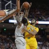 Photo - Texas' Prince Ibeh (44) is blocked by Baylor's Rico Gathers (2) during the first half of an NCAA college basketball game, Wednesday, Feb. 26, 2014, in Austin, Texas. (AP Photo/Eric Gay)
