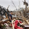 This volunteer looks for a place to begin searching through the rubble of a home. Volunteers from various parts of the country joined Oklahomans in assisting residents on Saturday, May 25, 2013, doing whatever was needed to remove debris and salvage items from this neighborhood east of Santa Fe, north of SW 19 Street. An EF5 tornado leveled many neighborhoods in Moore and southwest Oklahoma City last Monday. Photo by Jim Beckel, The Oklahoman.