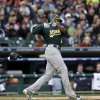 Oakland Athletics\' Coco Crisp hits a home run during the first inning of Game 1 of the American League division baseball series against the Detroit Tigers, Saturday, Oct. 6, 2012, in Detroit. (AP Photo/Paul Sancya)