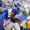 New York Giants wide receiver Victor Cruz (80) celebrates after catching his third touchdown pass of the game during the second half of an NFL football game against the Cleveland Browns Sunday, Oct. 7, 2012, in East Rutherford, N.J. (AP Photo/Julio Cortez)