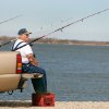 Jim Spreier fishes from the back of his pickup truck at Lake Overholser in Oklahoma City, Okla. Feb. 25, 2008. BY STEVE GOOCH, THE OKLAHOMAN