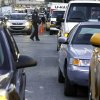 New York City Police Department officers manage the line of cars waiting for gasoline, in New York, Friday, Nov. 9, 2012. A new gasoline rationing plan that lets motorists fill up every other day went into effect in New York on Friday morning. Police were at gas stations to enforce the new system in New York City and on Long Island. (AP Photo/Richard Drew)