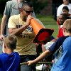 University of Oklahoma\'s (OU) co-offensive coordinator Jay Norvell\'s brother Aaron Norvell gets involved with Tug of War Tuesday during Jay\'s annual youth camp at Whittier Middle School on Tuesday, June 17, 2014 in Norman, Okla. Photo by Steve Sisney, The Oklahoman