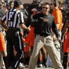 Oklahoma State head coach Mike Gundy argues a call with an official late in the second quarter during a college football game between the Oklahoma State University Cowboys (OSU) and the Kansas State University Wildcats (KSU) at Boone Pickens Stadium in Stillwater, Okla., Saturday, Oct. 5, 2013. Photo by Nate Billings, The Oklahoman