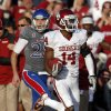 OU\'s Aaron Colvin (14) returns a blocked extra point kick for a safety as KU\'s Matthew Wyman (28) tries to chase him down in the fourth quarter during of the college football game between the University of Oklahoma Sooners (OU) and the University of Kansas Jayhawks (KU) at Memorial Stadium in Lawrence, Kan., Saturday, Oct. 19, 2013. OU won 34-19. Photo by Sarah Phipps, The Oklahoman
