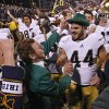 Notre Dame \'s Carlo Calabrese (44) celebrates the 30-13 win over Oklahoma during the college football game between the University of Oklahoma Sooners (OU) and the Notre Dame Fighting Irish at the Gaylord Family-Oklahoma Memorial Stadium on Saturday, Oct. 27, 2012, in Norman, Okla. Photo by Chris Landsberger, The Oklahoman