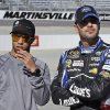 Jimmie Johnson, right, watches NASCAR Sprint Cup qualifying with driver Darrell Wallace Jr. at Martinsville Speedway in Martinsville, Va., Friday, April 5, 2013. Johnson won the pole for Sunday\'s race. (AP Photo/Steve Helber)