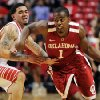 Oklahoma\'s Sam Grooms (1) drives past Texas Tech\'s Josh Gray during their NCAA college basketball game in Lubbock, Texas, Wednesday, Feb. 20, 2013. (AP Photo/The Avalanche-Journal, Stephen Spillman) ALL LOCAL TV OUT ORG XMIT: TXLUB107
