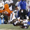 Oklahoma State\'s C.J Curry is tripped up by Savannah State\'s John Wilson (4) during a college football game between Oklahoma State University (OSU) and Savannah State University at Boone Pickens Stadium in Stillwater, Okla., Saturday, Sept. 1, 2012. Photo by Sarah Phipps, The Oklahoman