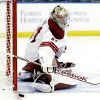 Photo - Phoenix Coyotes goalie Mike Smith (41) makes a save on a shot by the Tampa Bay Lightning during the second period of an NHL hockey game Monday, March 10, 2014, in Tampa, Fla. (AP Photo/Chris O'Meara)