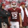 Oklahoma\'s Josh Heupel, Landry Jones and Sam Bradford look on from the sideline during the first half of the college football game between The University of Oklahoma Sooners (OU) and Idaho State University Bengals (ISU) at the Gaylord Family -- Oklahoma Memorial Stadium on Saturday, Sept. 12, 2009, in Norman, Okla. Photo by Chris Landsberger, The Oklahoman. ORG XMIT: KOD