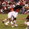 Oklahoma\'s Roy Finch (22) is brought down by Texas Tech\'s Tre\' Porter (5) during the college football game between the University of Oklahoma Sooners (OU) and the Texas Tech University Red Raiders (TTU) at Gaylord Family-Oklahoma Memorial Stadium in Norman, Okla., Saturday, Oct. 22, 2011. Photo by Bryan Terry, The Oklahoman