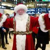 In this photo provided by the New York Stock Exchange, a man portraying Santa Claus visits the trading floor of the New York Stock Exchange, Wednesday Nov. 21, 2012 before he participated in opening bell ceremonies featuring the Macy\'s Thanksgiving Day Parade. Stocks hovered near break-even Wednesday on Wall Street ahead of the Thanksgiving holiday. (AP Photo/NYSE Euronext, Ben Hider)