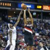 Portland Trail Blazers forward Nicolas Batum (88) shots over Sacramento Kings defender John Salmons during the first half of an NBA basketball game in Sacramento, Calif., on Sunday, Dec. 23, 2012. (AP Photo/Steve Yeater)