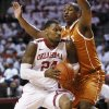 Oklahoma\'s Romero Osby (24) drives to the basket against Texas\' Jonathan Holmes (10) during an NCAA college basketball game in Norman, Okla., Monday, Jan. 21, 2013. (AP Photo/The Oklahoman, Nate Billings)