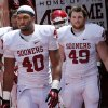 P. L. Lindley (40) and David Driskill (49) step onto the filed before the annual Spring Football Game at Gaylord Family-Oklahoma Memorial Stadium in Norman, Okla., on Saturday, April 13, 2013. Photo by Steve Sisney, The Oklahoman