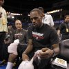 Miami Heat player LeBron James adjusts an ice pack on his knee as he prepares to speak to the media after practice for the first game of the NBA basketball finals at the Chesapeake Arena on Tuesday, June 12, 2012 in Oklahoma City, Okla. Photo by Steve Sisney, The Oklahoman