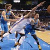 Oklahoma City Thunder\'s Russell Westbrook (0) fights for a loose ball with New Orleans Hornets\' Austin Rivers (25) and Robin Lopez (15) during the NBA basketball game between the Oklahoma CIty Thunder and the New Orleans Hornets at the Chesapeake Energy Arena on Wednesday, Dec. 12, 2012, in Oklahoma City, Okla. Photo by Chris Landsberger, The Oklahoman