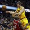 Cleveland Cavaliers\' Tyler Zeller charges into Atlanta Hawks\' Anthony Tolliver (4) in the second quarter of an NBA basketball game, Friday, Dec. 28, 2012, in Cleveland. (AP Photo/Mark Duncan)