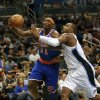 Photo -   New York Knicks' Ronnie Brewer (11) drives to the basket past Orlando Magic's Glen Davis, right, during the first half of an NBA basketball game, Tuesday, Nov. 13, 2012, in Orlando, Fla. (AP Photo/John Raoux)