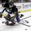 Photo - Pittsburgh Penguins' Evgeni Malkin (71), of Russia, tumbles over Montreal Canadiens' Josh Gorges as he goes for the puck during the second period of an NHL hockey game, Thursday, Feb. 27, 2014 in Pittsburgh. (AP Photo/Keith Srakocic)
