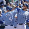 Photo - Kansas City Royals' Alex Gordon (4) is congratulated by teammate Eric Hosmer (35) after his three-run home run during the fifth inning of a baseball game against the Tampa Bay Rays at Kauffman Stadium in Kansas City, Mo., Wednesday, April 9, 2014. (AP Photo/Orlin Wagner)