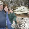 Jerry and Jammy England with the burned out Cory\'s Cabin that was destroyed in Thursdays fires north of Lindsay, Friday, April 10, 2009. Cory\'s Cabin was belt to honor her son who died of cancer and was used as a church retreat and wedding were held there. Photo By David McDaniel, The Oklahoman.