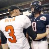 OSU quarterback Brandon Weeden (3) talks to Arizona quarterback Nick Foles (8) after the Valero Alamo Bowl college football game between the Oklahoma State University Cowboys (OSU) and the University of Arizona Wildcats at the Alamodome in San Antonio, Texas, Wednesday, December 29, 2010. OSU won, 36-10. Photo by Nate Billings, The Oklahoman