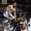 Indiana Pacers\' Roy Hibbert, right, looks to pass as Charlotte Bobcats\' Gerald Henderson, left, leaps high to block during the first half of an NBA basketball game in Charlotte, N.C., Tuesday, Jan. 15, 2013. (AP Photo/Chuck Burton)