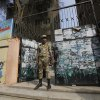 Photo - An Egyptian army soldier stands guard in front of a polling station in Cairo, Egypt, Monday, Jan. 13, 2014. The January 14-15 vote on the draft constitution will be the first real test of the post-Morsi regime. A comfortable