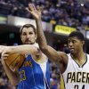New Orleans Hornets\' Ryan Anderson (33) grabs a rebound from Indiana Pacers\' Paul George during the second half of an NBA basketball game, Wednesday, Nov. 21, 2012, in Indianapolis. The Pacers won 115-107 in overtime. (AP Photo/Darron Cummings)