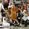 Oklahoma State\'s Stevie Clark (5) and Markel Brown (22) defend Texas\' Javan Felix (3) during an NCAA college basketball game between the Oklahoma State Cowboys (OSU) and the University of Texas Longhorns at Gallagher-Iba Arena in Stillwater, Okla., Wednesday, Jan. 8, 2014. Photo by Bryan Terry, The Oklahoman
