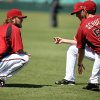 Photo - The Arizona Diamondbacks' Bo Schultz, right, and fellow pitcher Wade Miley chat as they stretch during a workout at the Sydney Cricket Ground in Sydney, Tuesday, March 18, 2014. The Major League Baseball season-opening two-game series between the Los Angeles Dodgers and Arizona Diamondbacks in Sydney will be played this weekend. (AP Photo/Rick Rycroft)