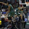 Milwaukee Bucks\' Larry Sanders (8) and Brandon Jennings celebrate after teammate Monta Ellis made a three-point basket in the final seconds of an NBA basketball game against the Orlando Magic, Sunday, March 17, 2013, in Milwaukee. The Bucks won 115-109. (AP Photo/Morry Gash)