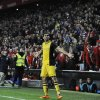 Atletico de Madrid\'s Diego Costa of Brazil, celebrates beside Athletic Bilbao\'s supporters after scoring his goal, during their Spanish Copa del Rey round-8 second leg soccer match against Athletic Bilbao, at San Mames stadium, in Bilbao, northern Spain, Wednesday, Jan. 29, 2014. (AP Photo/Alvaro Barrientos)