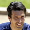 Photo - Italy goalkeeper Gianluigi Buffon smiles as he arrives at a training session in Coverciano training complex, in Florence, Italy, Tuesday, May 20 , 2014,   Italy opened its World Cup training camp Monday with 31 players.  Coach Cesare Prandelli needs to trim his squad to 23 players by June 2.  In Brazil, Italy is in Group D with England, Uruguay and Costa Rica. (AP Photo/Fabrizio Giovannozzi)