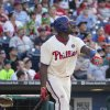 Photo - Philadelphia Phillies' Ryan Howard watches his 3-run home run during the seventh inning of a baseball game against the New York Mets, Saturday, May 31, 2014, in Philadelphia. This home run would give Howard his 1,000th career RBI. (AP Photo/Chris Szagola)