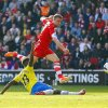Photo - Southampton's Rickie Lambert, top, shoots past Newcastle United's Mapou Yanga-Mbiwa during their English Premier League soccer match at St Mary's, Southampton, England, Saturday, March 29, 2014. (AP Photo/Chris Ison, PA Wire)    UNITED KINGDOM    -    NO SALES   -   NO ARCHIVES
