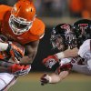 Oklahoma State\'s Desmond Roland (26) runs through the Tech defense during the college football game between the Oklahoma State University Cowboys (OSU) and Texas Tech University Red Raiders (TTU) at Boone Pickens Stadium on Saturday, Nov. 17, 2012, in Stillwater, Okla. Photo by Chris Landsberger, The Oklahoman