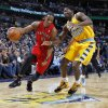 Toronto Raptors guard DeMar DeRozan, left, works the ball inside past Denver Nuggets forward Kenneth Faried during the first quarter of an NBA basketball game in Denver on Monday, Dec. 3, 2012. (AP Photo/David Zalubowski)