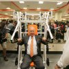 COLLEGE FOOTBALL / OSU: Oklahoma State University\'s strength and conditioning coach Rob Glass watches as T. Boone Pickens uses a weight machine during a tour of the west end zone of Boone Pickens Stadium\'s facilities in Stillwater, Oklahoma August 17, 2009. Photo by Steve Gooch, The Oklahoman ORG XMIT: KOD