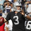 Photo -   Oakland Raiders quarterback Carson Palmer (3) looks to throw against the Dallas Cowboys during the first quarter of an NFL preseason football game in Oakland, Calif., Monday, Aug. 13, 2012. (AP Photo/Tony Avelar)