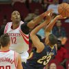 Photo - New Orleans Pelicans forward Anthony Davis (23) has his shot blocked by Houston Rockets center Dwight Howard (12) during the first half of a preseason NBA basketball game in Houston, Saturday, Oct. 5, 2013. (AP Photo/Richard Carson)