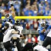 Baltimore Ravens kicker Justin Tucker (9) kicks a 61-yard field goal during the fourth quarter of an NFL football game against the Detroit Lions. The Ravens defeated the Lions 18-16 in Detroit, Monday, Dec. 16, 2013. (AP Photo/Paul Sancya)