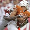 Oklahoma\'s Tony Jefferson (1) sacks Texas quarterback David Ash (1) during the Red River Rivalry college football game between the University of Oklahoma Sooners (OU) and the University of Texas Longhorns (UT) at the Cotton Bowl in Dallas, Saturday, Oct. 8, 2011. Photo by Chris Landsberger, The Oklahoman